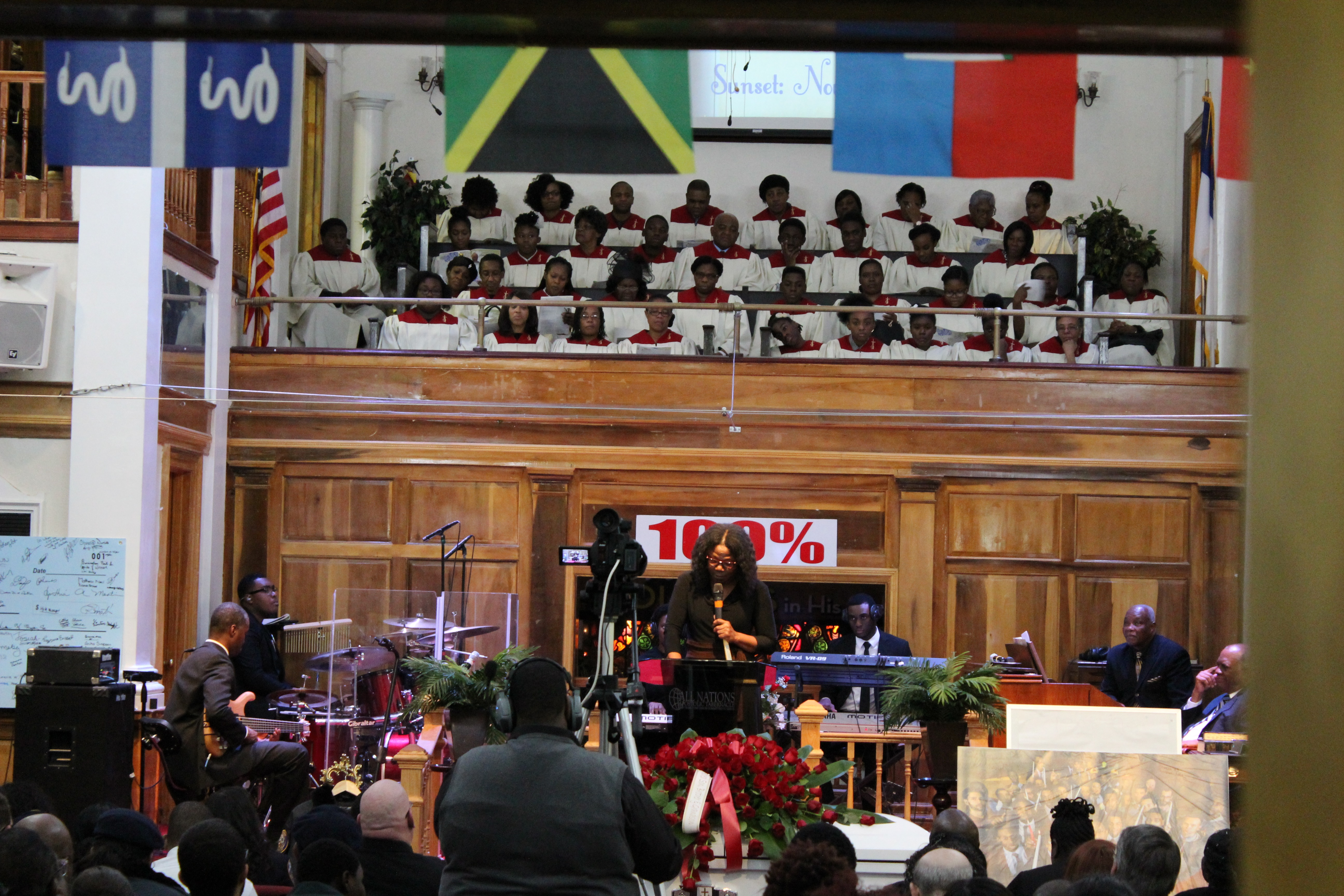 Karen Jones (podium) delivers Delano Cowan's eulogy at the All Nation's Apostolic Tabernacle church in Queens, New York on December 4, 2015.