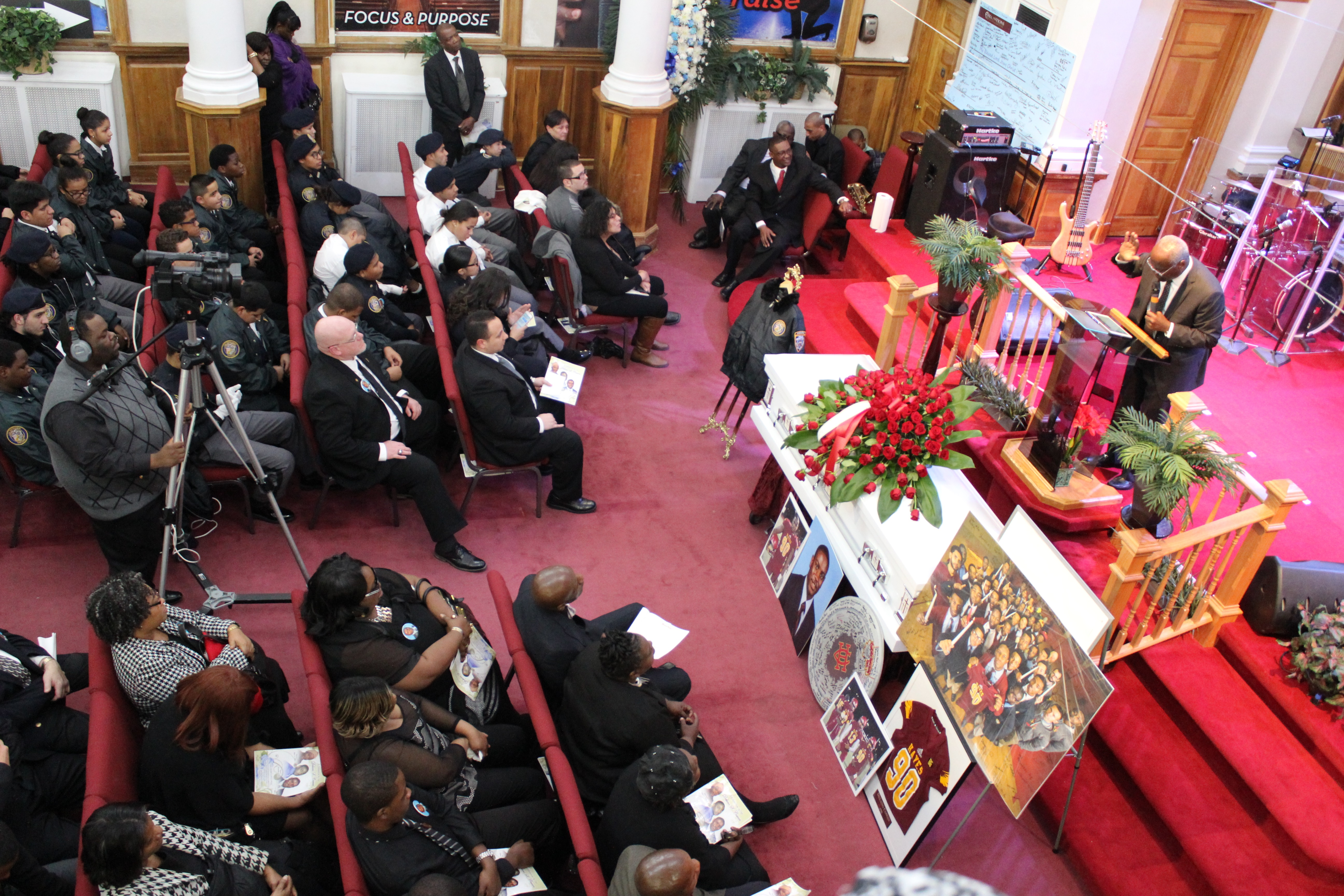 Pastor of All Nations Apostolic Tabernacle church in Queens, New York, the Rev. Devon Dawson delivers the message at the funeral of Cardinal Hayes High School football player Delano Cowan, on December 4, 2015.